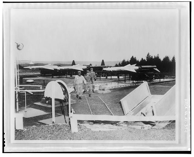 Photocopy of photograph showing unidentified launch area with personnel door, decontamination shower and Ajax missiles from photo archives at U. S. Institute for Military History, Carlisle Barracks, Carlisle, PA, no date