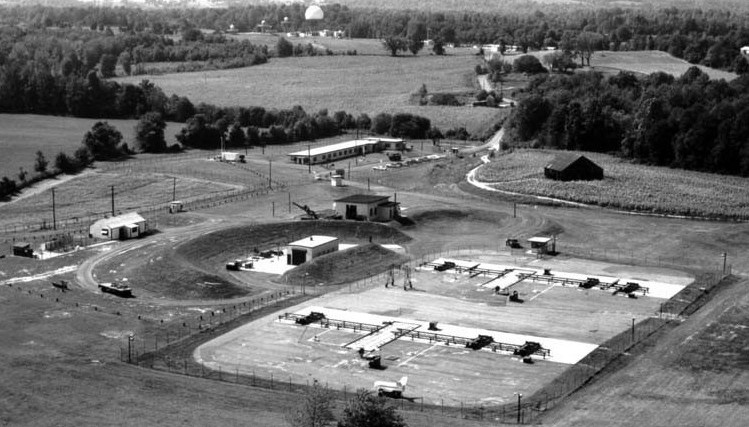 Looking almost due west across the launcher area (foreground) to the integrated fire control (IFC) area (center background) in 1964. The launcher area serves as the Anne Arundel County Police Academy, while the IFC area is the Davidsonville Family Recreation Center.